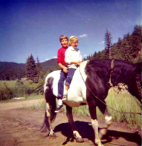 My horse crazy mother and her equally horse fanatic sister, at a young age, enjoying a ride on Thunder.