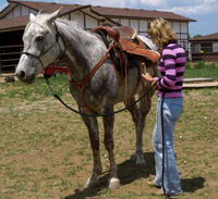 Desensitizing the horse to motion against the sides of their body is a good idea before riding to ensure that you do not have an overtly sensitive horse once you are in the saddle. With a relaxed stance in your body swing and bounce the stirrup until the horse can stand still and relax.