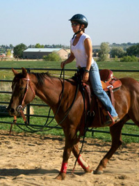 This rider rides with on a loose rein as she practices Go With the Flow Riding in the Standing Position.